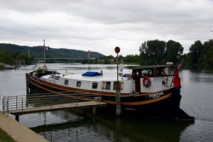 TORTUS moored in front of the restaurant